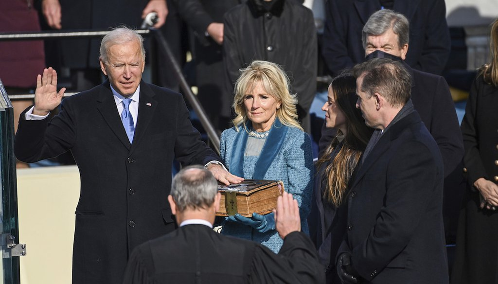 Joe Biden is sworn in as the 46th president of the United States by Chief Justice John Roberts as Jill Biden holds the Bible during the 59th Presidential Inauguration at the U.S. Capitol in Washington, Jan. 20, 2021. (AP)