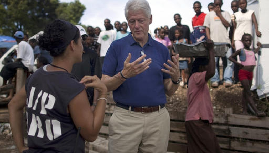 In this Oct. 6, 2010, file photo, former president and UN special envoy to Haiti, Bill Clinton, visits a camp for people who were displaced by the Jan. 12 earthquake in Port-au-Prince, Haiti. (AP)