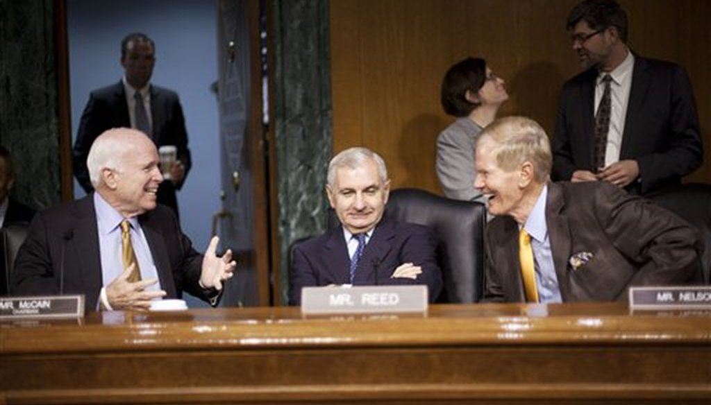 Senate Armed Services Committee Chairman Sen. John McCain, R-Ariz., left, talks with the committee's ranking member, Sen. Jack Reed, D-R.I., center, and Sen. Bill Nelson, D-Fla., right, before the committee's hearing about Iraq on Sept. 16, 2015. (AP)