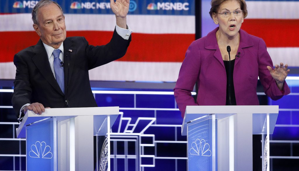 Democratic presidential candidates Mike Bloomberg, left, and  Elizabeth Warren gesture during a primary debate on Feb. 19, 2020, in Las Vegas. (AP)