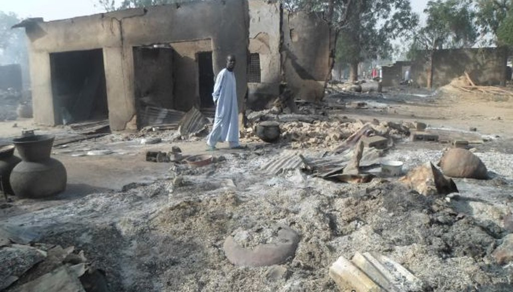A man walks past burned-out houses following an attack by the Islamic terrorist group Boko Haram near Maiduguri, Nigeria, on Jan. 31, 2016. (AP/Jossy Ola)