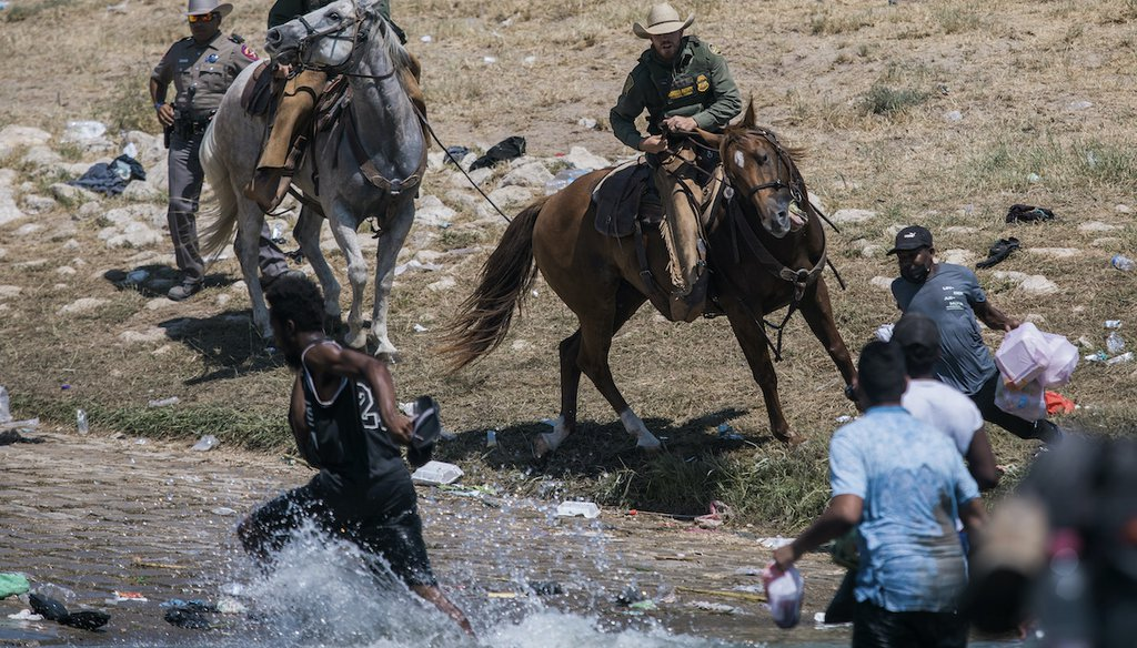U.S. Customs and Border Protection mounted officers attempt to contain migrants as they cross the Rio Grande from Ciudad Acuña, Mexico, into Del Rio, Texas, Sunday, Sept. 19, 2021. Thousands of Haitian migrants have been arriving to Del Rio, Texas. (AP)