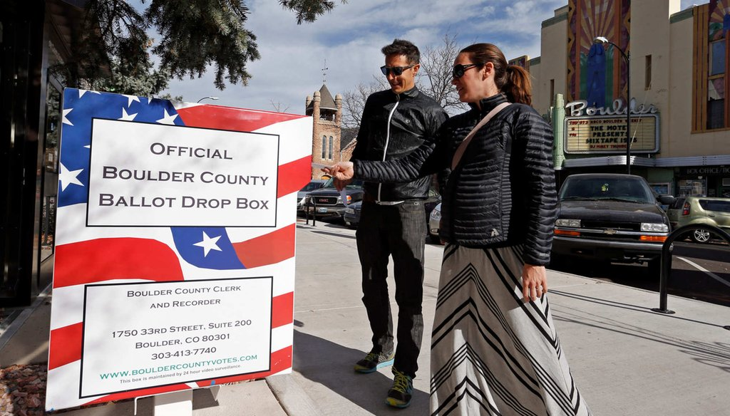 In the battle ground state of Colorado, Megan Monroe, right, and Brian Fuentes drop of their ballots at an electoral drop box, in Boulder, Colo. Ease of voting in Colorado means that almost half the state had voted four days before Election Day. (AP Photo