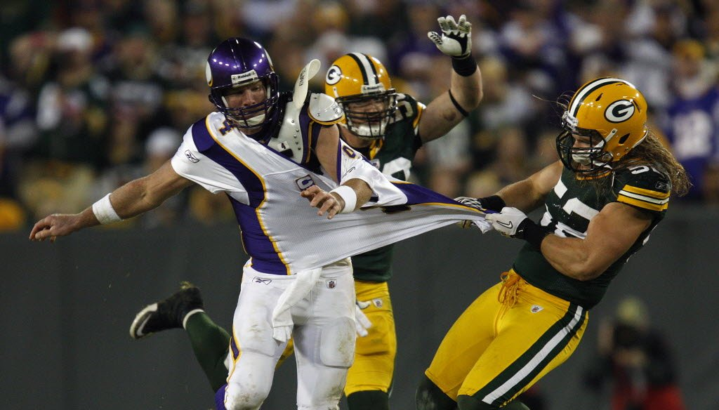 Former Green Bay Packers quarterback Brett Favre, playing for the Minnesota Vikings, is grabbed by Packers defender Clay Matthews during a game at Lambeau Field on Oct. 24, 2010. (Milwaukee Journal Sentinel photo)
