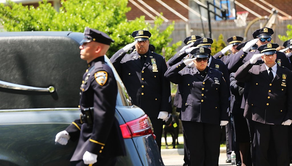 The hearse carrying fallen New York City police officer Brian Moore leaves church on May 8. Ph