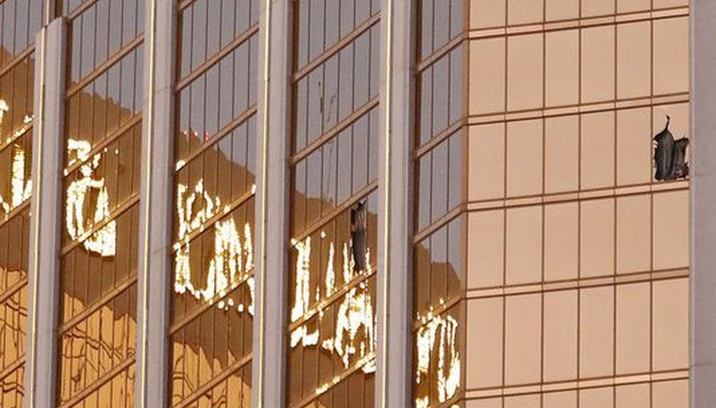 Broken windows are seen on a high floor of the Mandalay Bay hotel in Las Vegas following a mass shooting on Oct. 1, 2017. (Paul Buck/EPA-EFE)