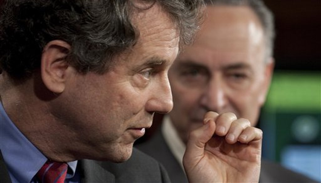 Sen. Sherrod Brown, D-Ohio, left, accompanied by Sen. Charles Schumer, D--N.Y., gestures during a news conference on Capitol Hill in Washington, March 3, 2010. (AP)