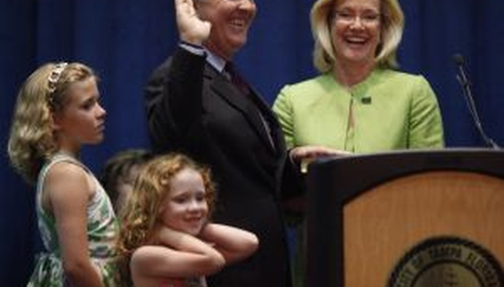 Tampa Mayor Bob Buckhorn, pictured here with his family, was sworn in on April 1, 2011.