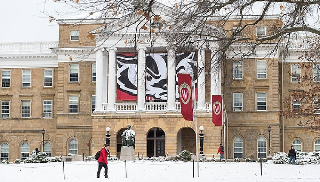 A banner with a graphic of mascot Bucky Badger's face hung between the columns of Bascom Hall at the University of Wisconsin-Madison on Nov. 25, 2014. (UW-Madison photo)