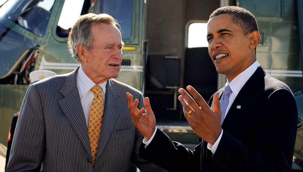 Former president George H.W. Bush and President Barack Obama honored community service leaders in 2009. The two also share a readiness to act unilaterally on immigration. (Getty Images)