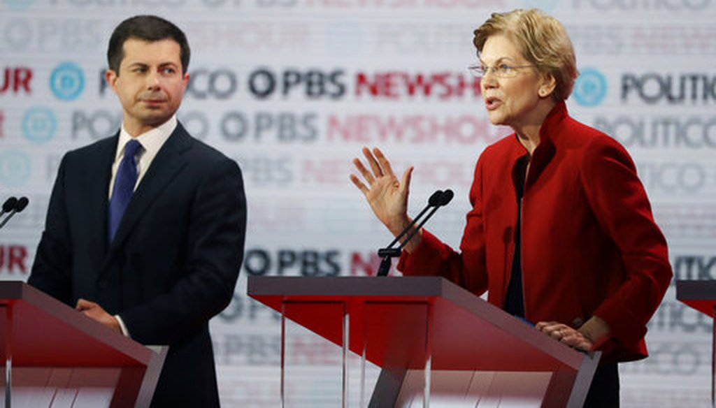 Democratic presidential candidate Sen. Elizabeth Warren, D-Mass., right, speaks as South Bend Mayor Pete Buttigieg listens during a Democratic presidential primary debate Thursday, Dec. 19, 2019, in Los Angeles. (AP)