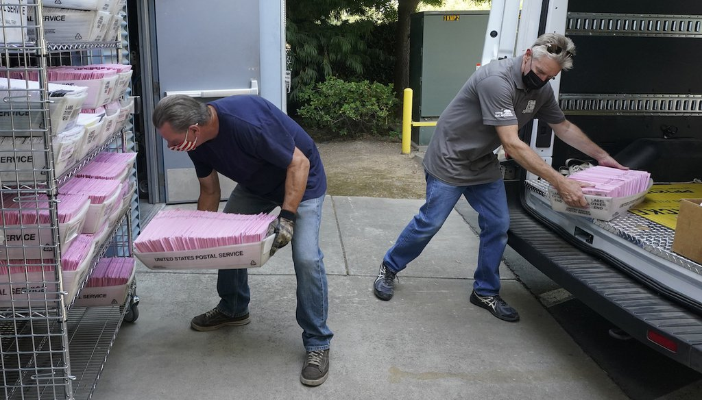 In this Aug. 30, 2021 file photo, Tim Rasmussen, left and Karl Vostrez, right deliver mail-in ballots for the Sept. 14th, recall election at the Sacramento County Registrar of Voters office in Sacramento, Calif. (AP)