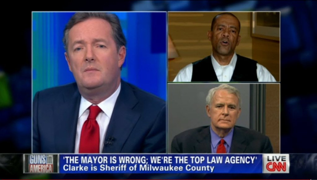 After Milwaukee County Sheriff David A. Clarke Jr. (top right) aired a controversial radio ad about crime, he and Milwaukee Mayor Tom Barrett (bottom right) were interviewed by CNN talk show host Piers Morgan on Jan. 29, 2013.