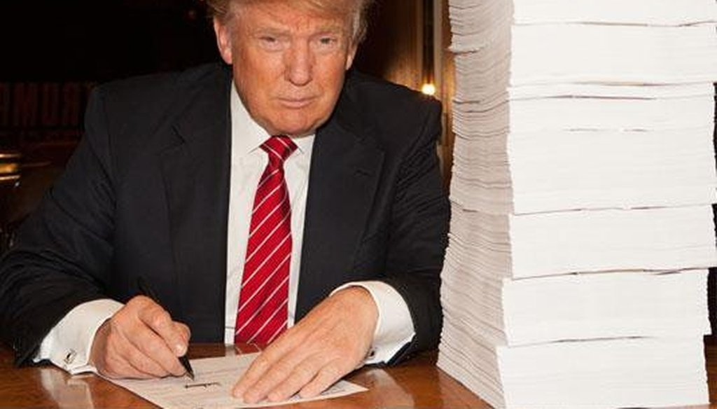 Donald Trump tweeted this picture of himself signing his tax return in October 2015. (Photo via Twitter)