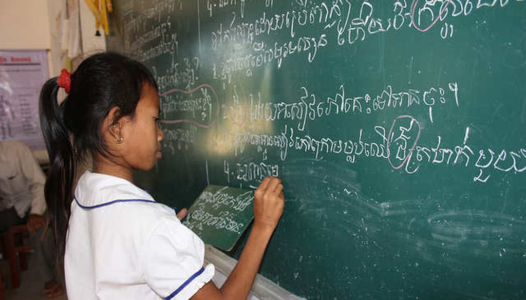 A girl completes an exercise at a school in Cambodia (Global Partnership for Education)