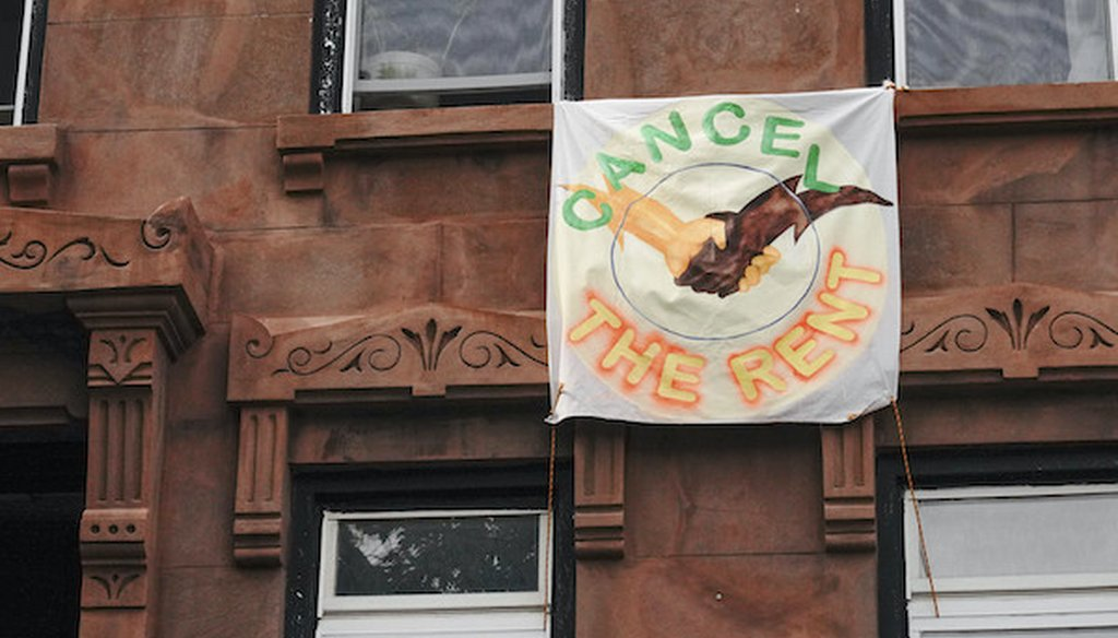"A view of a sign saying, ""Cancel the Rent,"" during the coronavirus pandemic on May 18, 2020, in Brooklyn. (AP)"