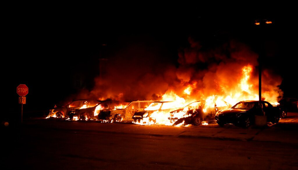 Cars set ablaze amid violent protests burn at the Car Source in Kenosha on Aug. 24, 2020. (Photo by KAMIL KRZACZYNSKI / AFP)