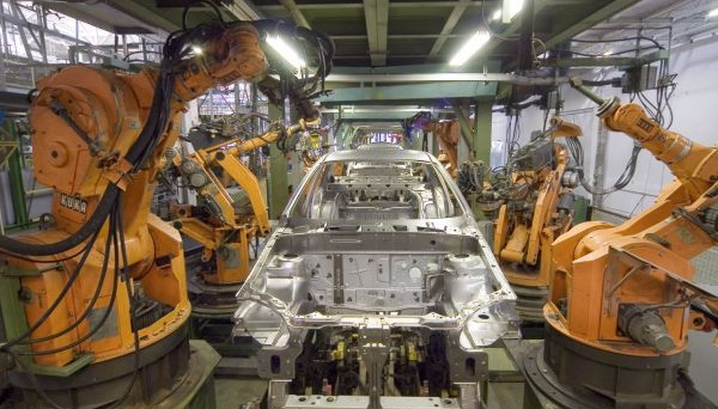 Robots are widely used in automobile manufacturing, but the number of human workers has been rising recently, too. (Wikimedia Commons)