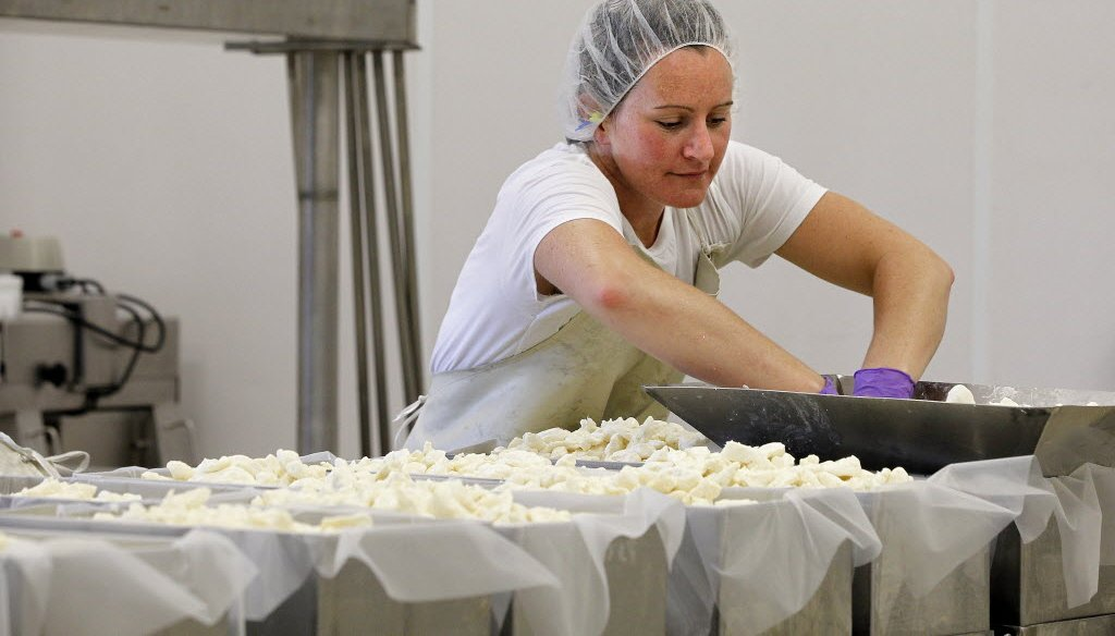 Cara Wagner works in the cheese making room at LaClare Farms, a dairy goat farm near Malone, Wis.