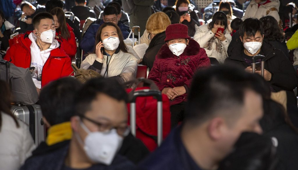 Travelers wear face masks as they sit in a waiting room at the Beijing West Railway Station in Beijing on Jan. 21, 2020. Chinese authorities are responding to an outbreak of a new coronavirus that started in Wuhan, China. (AP)