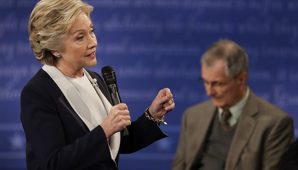 Democratic presidential nominee Hillary Clinton answers a question during the second presidential debate at Washington University in St. Louis, Sunday, Oct. 9, 2016. (AP Photo/Julio Cortez)