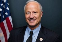 Rep. Mike Coffman says Hillary Clinton 'breaks the law.' It's complicated