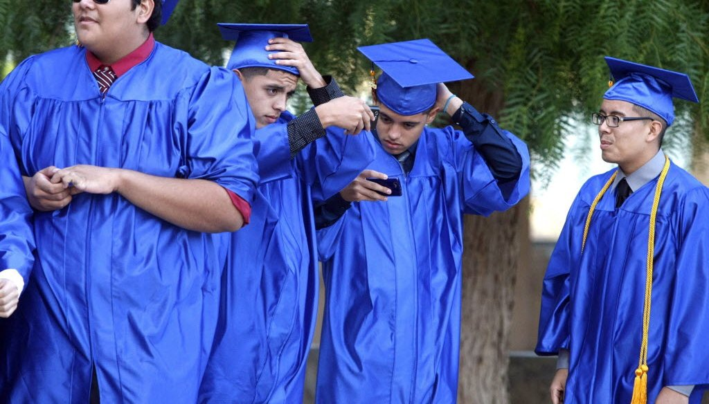 These four young men graduated from a Los Angeles high school in June 2013. If they opt for college, will it take them six years to earn a four-year degree? (Los Angeles Times/MCT photo)