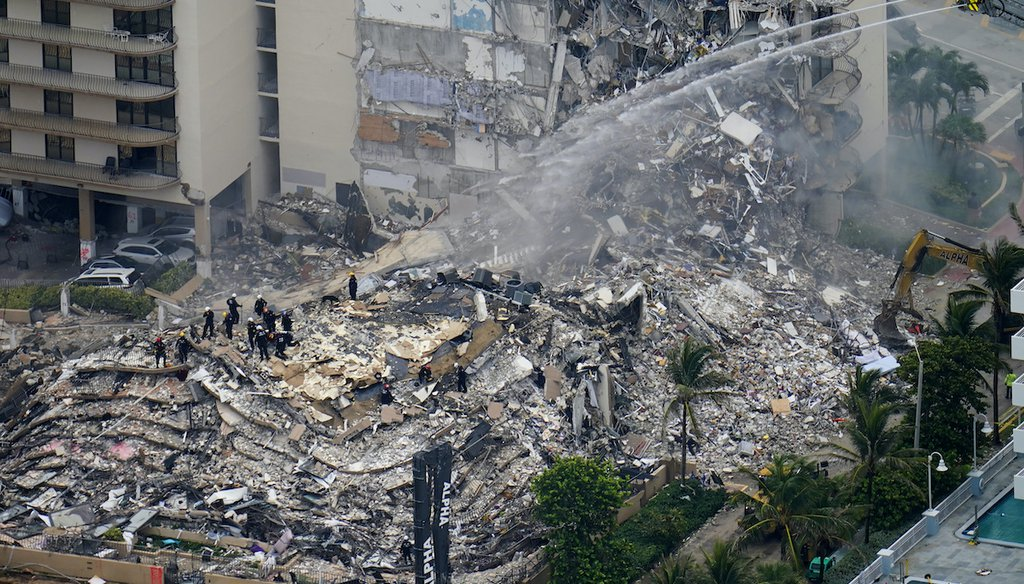 Rescue workers work in the rubble at the Champlain Towers South in Surfside, Fla. on June 25, 2021 (AP)