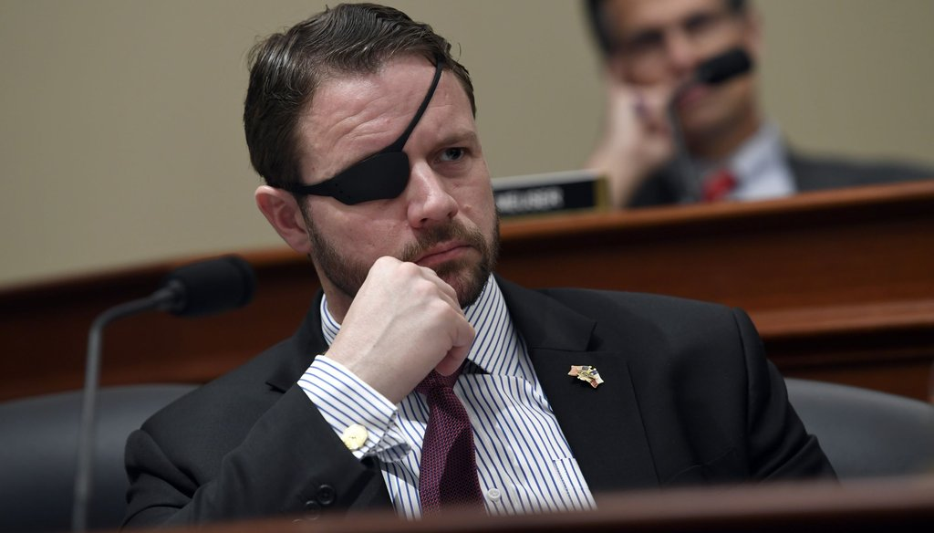 U.S. Rep. Dan Crenshaw, R-Texas, listens to testimony during a congressional hearing in March. (AP Photo/Susan Walsh)