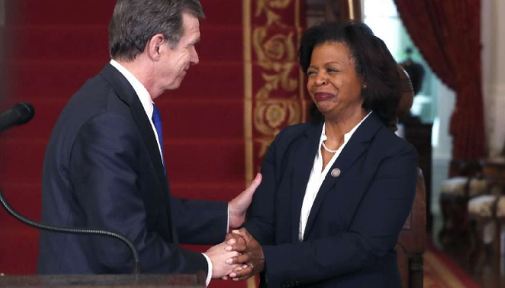 North Carolina Gov. Roy Cooper, left, congratulates Cheri Beasley after naming her as the next Chief Justice of the NC Supreme Court during a press conference in Raleigh on Feb. 12, 2019. (News & Observer)