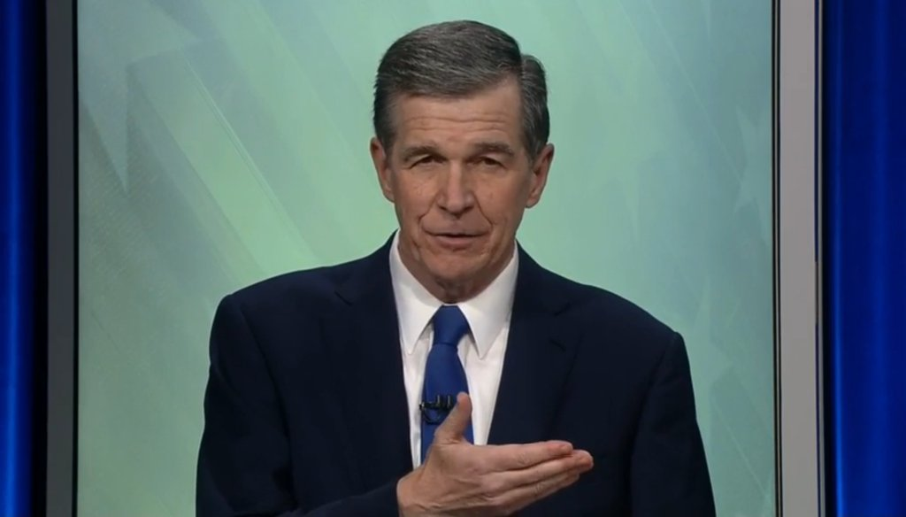 North Carolina Gov. Roy Cooper, a Democrat, talks about his opponent's position on Opportunity Scholarships during a debate on Oct. 14, 2020.