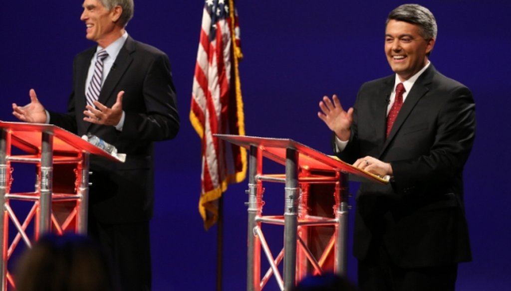 Sen. Mark Udall, D-Colo., left, and U.S. Rep. Cory Gardner, R-Colo., greet the audience at the start of a televised debate on Oct. 15, 2014.