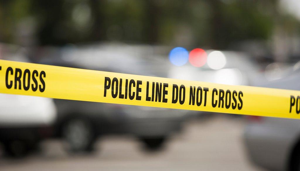 Cordon tape around an active crime scene. (Shutterstock)