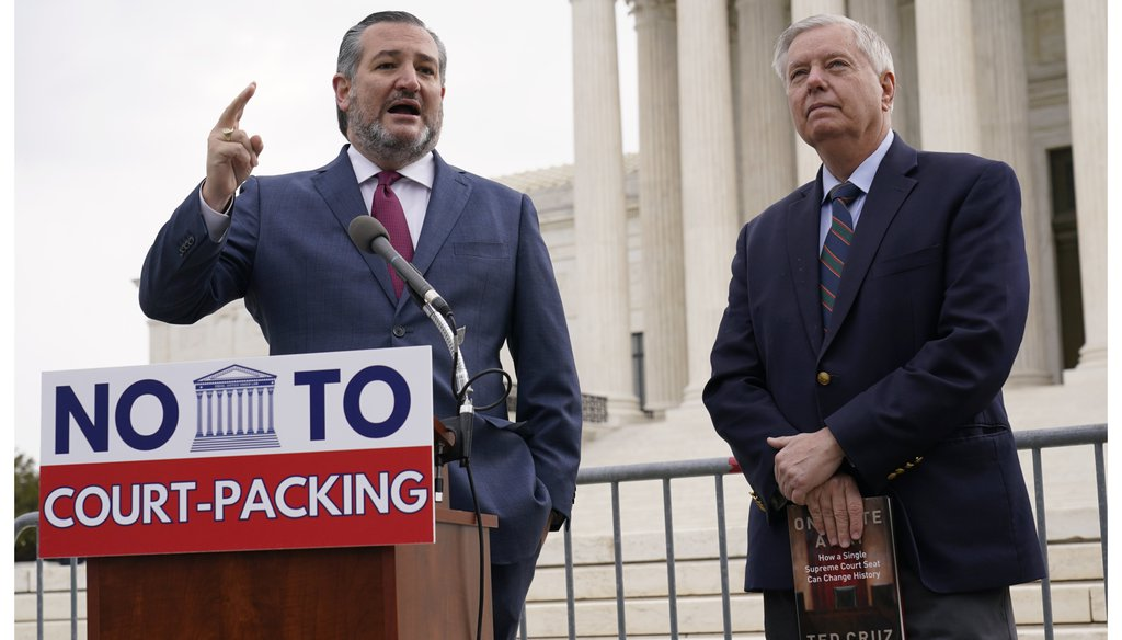 Sen. Ted Cruz, R-Texas, left, speaks as Sen. Lindsey Graham, R-S.C., right, listens during a news conference outside the Supreme Court in Washington, Thursday, April 22, 2021. (AP Photo/Susan Walsh)