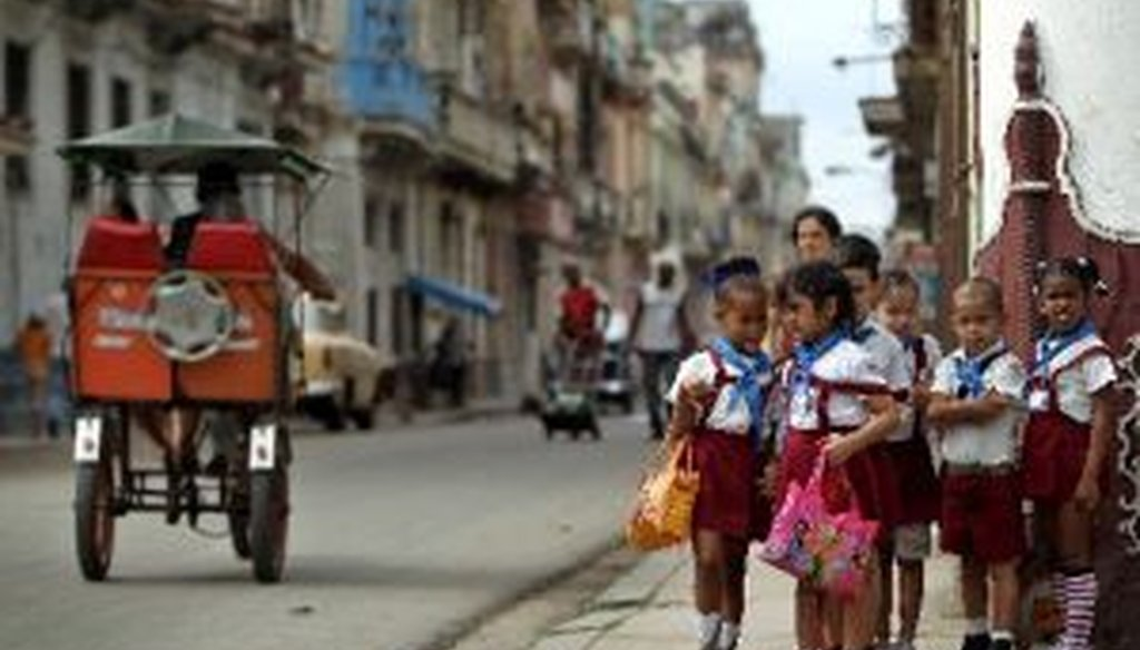 Children are seen on a corner of a street in Havana, Cuba, in January 2014. We looked at some statistical comparisons on health between Cuba and the United States.