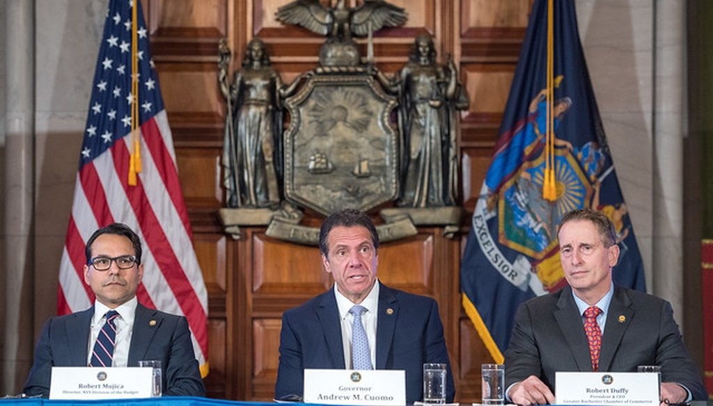 Gov. Andrew Cuomo, center, gives an update on the budget on March 11, 2019. At left is Budget Director Robert Mujica, at right is Greater Rochester Chamber of Commerce CEO Robert Duffy.  (credit: flickr/governorandrewcuomo)