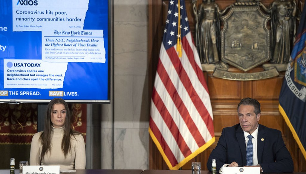 Gov. Andrew Cuomo gives a coronavirus update on May 20, 2020, in the State Capitol. At left is Mariah Kennedy Cuomo. (courtesy Gov. Andrew Cuomo's office)