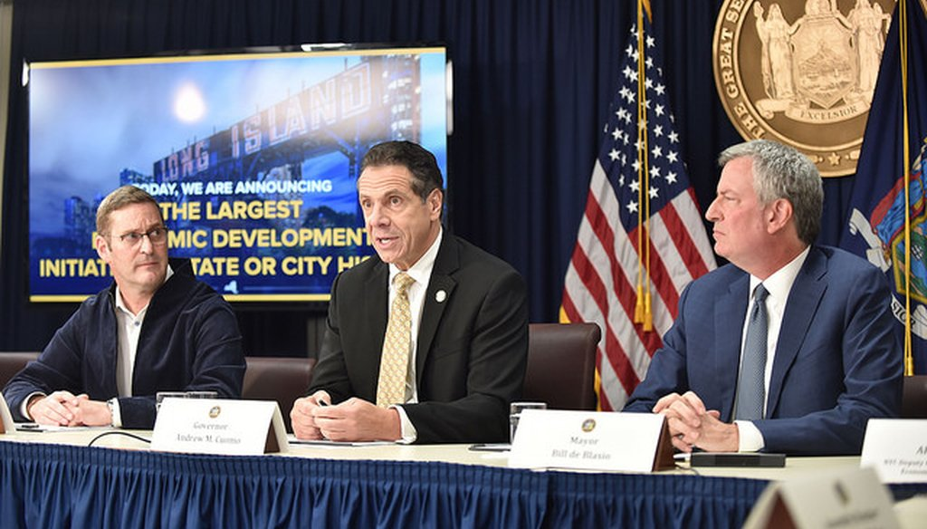Gov. Andrew Cuomo, New York City Mayor Bill de Blasio, and John Schoettler, vice president of global real estate and facilities for Amazon, announce a deal to bring Amazon to Queens. (Courtesy Gov. Andrew Cuomo)