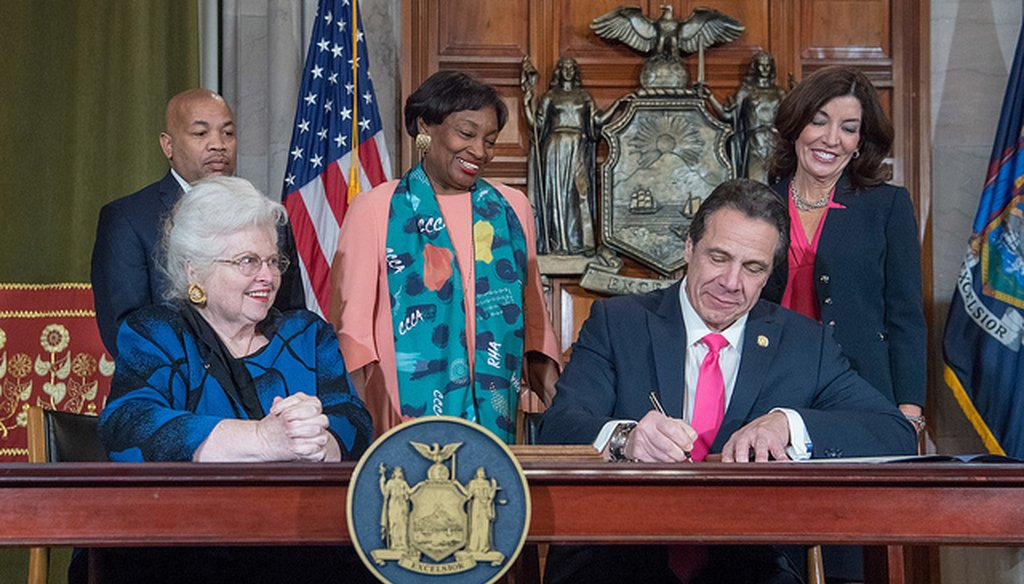 Gov. Andrew Cuomo signs the Reproductive Health Act into law in the Red Room in the State Capitol on Jan. 22, 2019. (flickr/governorandrewcuomo)