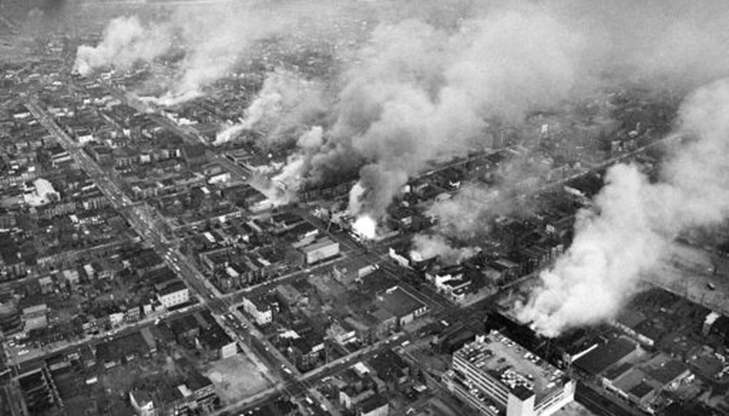 In this April 5, 1968 file photo, buildings burn along H Street in the northeast section of Washington, set afire during a day of demonstrations and rioting in reaction to the assassination of Dr. Martin Luther King Jr. (AP)