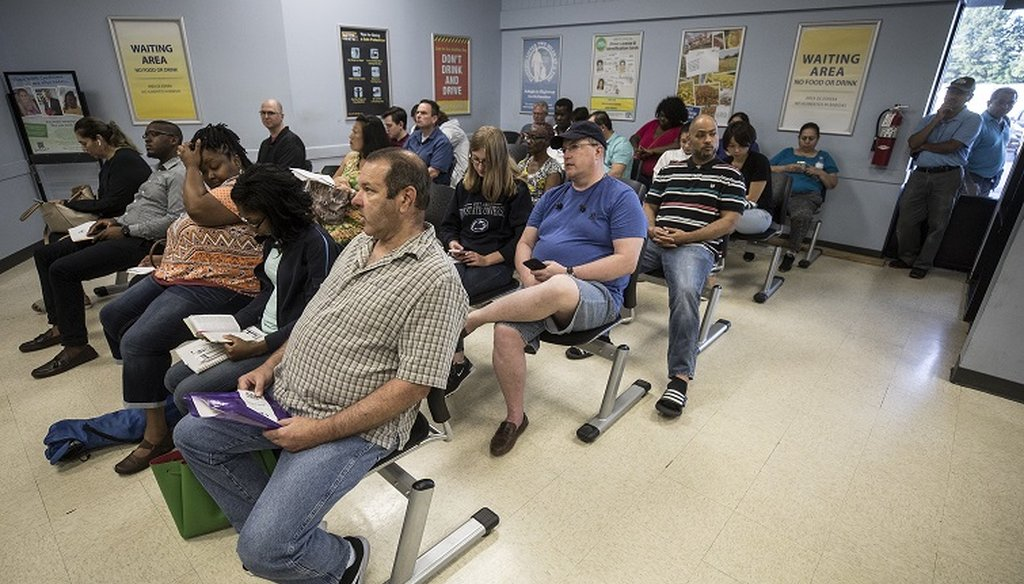 North Carolina residents wait inside the DMV on Spring Forest Road in Raleigh, many of them hoping to obtain a Real ID, on Wednesday, August 8, 2018. (Julia Wall/N&O)