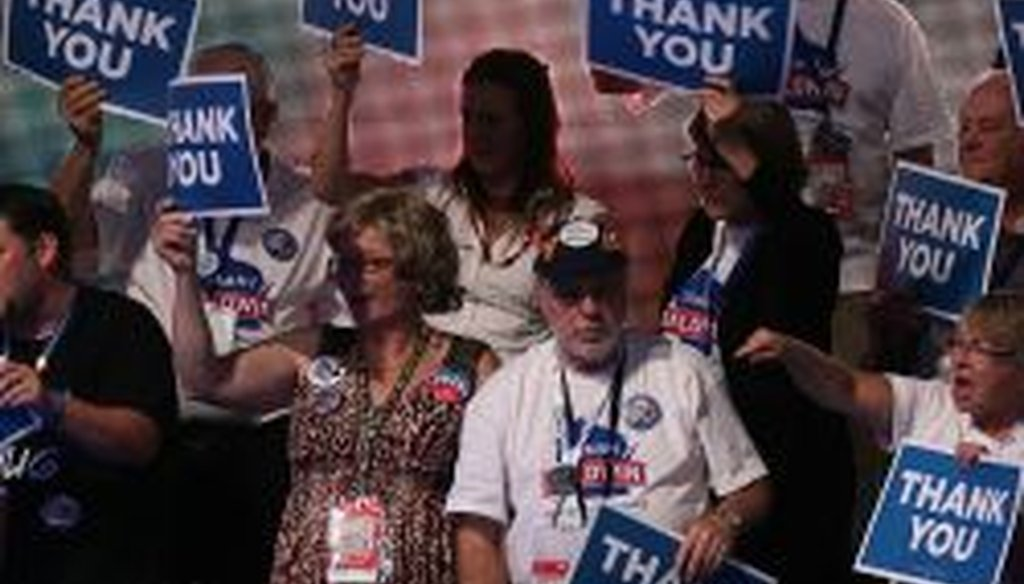 """Delegates hold up """"Thank You"""" signs during day three of DNC in Charlotte on Thursday. President Obama's nomination acceptance speech was aimed at convincing voters that a slow economic recovery will accelerate if they give him a second term."""