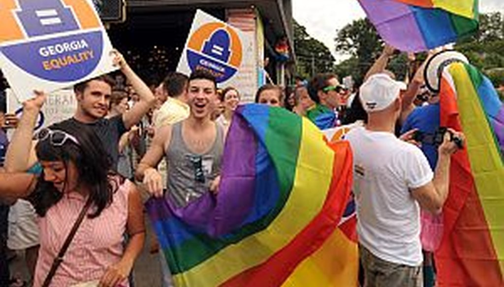 Gay rights supporters in Midtown Atlanta cheer the Supreme Court ruling on gay marriage on June 26, 2013. Ga. Rep. Ed Lindsey says marriage act author Bob Barr has changed his position on the issue over the years. (AJC Photo/Kent D. Johnson)