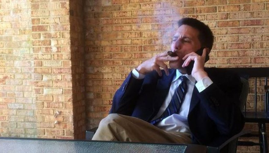 Dallas Woodhouse, executive director of the North Carolina Republican Party, takes a smoke break outside his office while checking in with party officials. (Courtesy of N&O/Bryan Anderson)