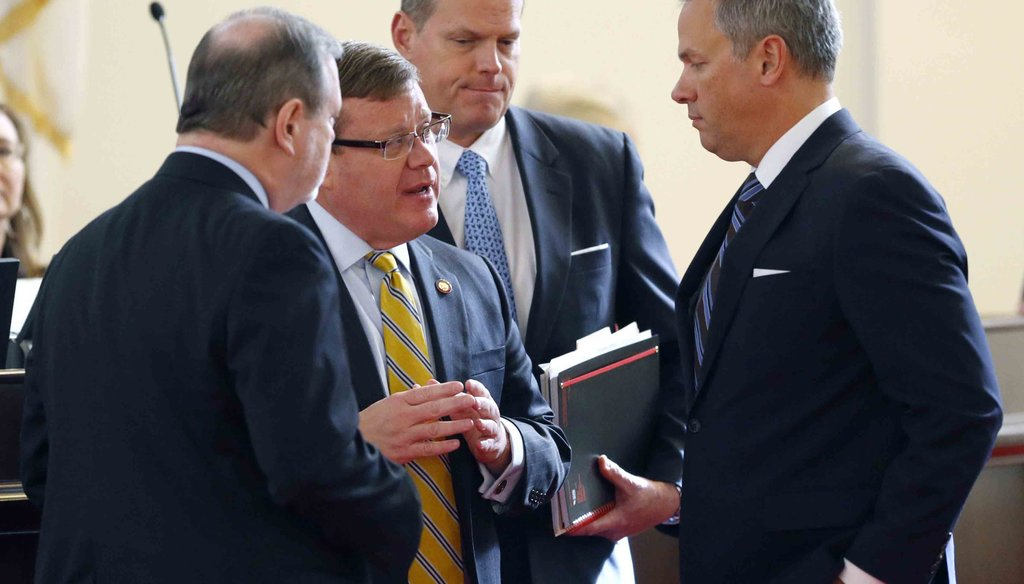 NC Lt. Gov. Dan Forest, right, talks with Republican legislative leaders Sen. Phil Berger, left, and Rep. Tim Moore, second from left. News & Observer photo.