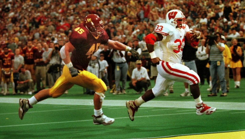 Wisconsin has dominated Minnesota in college football since Badgers running back Ron Dayne was scoring on them, like he did here in 1999. But these days, which state is better for business?
