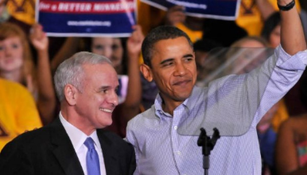 Mark Dayton, then running for his first term as Minnesota governor, and President Barack Obama,  wave to the crowd during a get-out-the-vote rally at the University of Minnesota in October 2010.