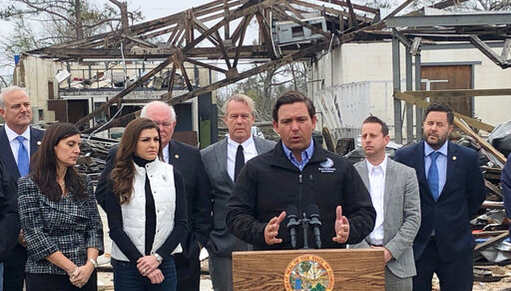 Florida Gov. Ron DeSantis announces that President Donald Trump is committing hundreds of millions of dollars in extra money to reimburse the state for Hurricane Michael cleanup Thursday, Jan. 24, 2019, in Marianna, Fla. (AP)