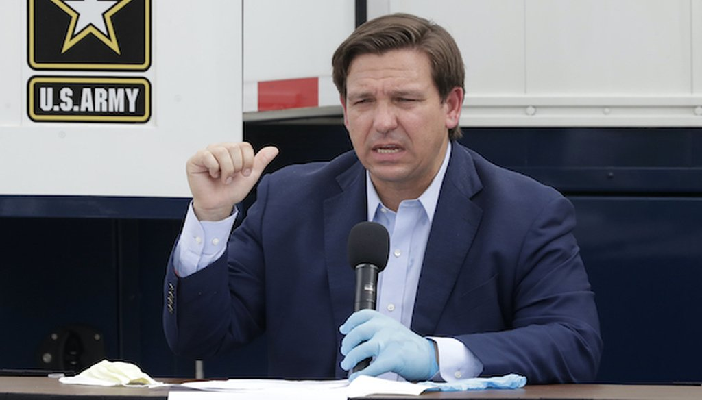 Florida Gov. Ron DeSantis gestures as he speaks during a news conference in front of a U.S. Army Corps of Engineers mobile command center at the Miami Beach Convention Center on April 8, 2020. (Associated Press)