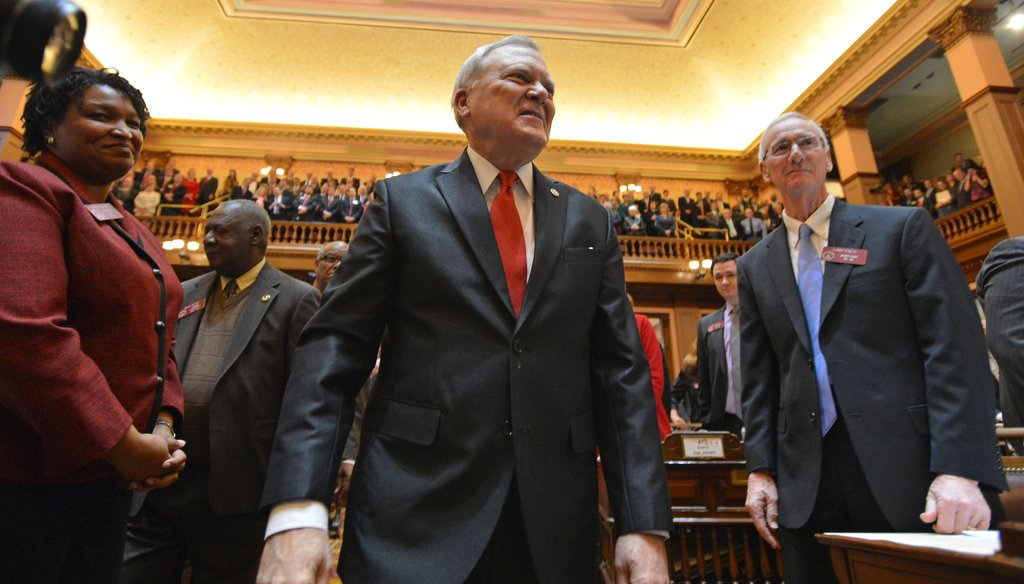 Georgia Gov. Nathan Deal is welcomed to the House floor before delivering the State of the State speech. Photo Credit: Brant Sanderlin/AJC.